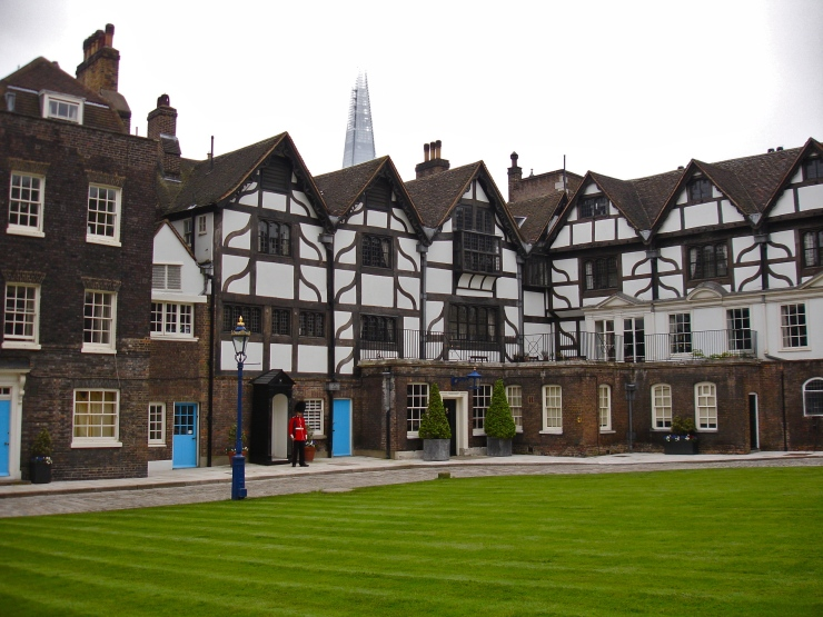 View of Tower Green (site of numerous beheadings) and Queen's House, where the Tower's Resident Governor lives and originally held prisoners that included Lady Jane Grey and Guy Fawkes